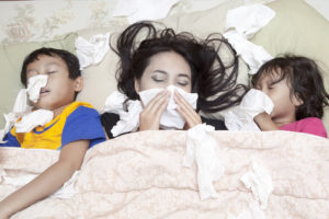 Family is lying on a bed with flu - direct primary care Oak Brook, IL