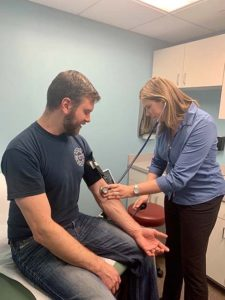 man getting blood pressure checked at Vitality Family Health - High Blood Pressure