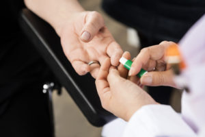 Doctor Using Tool On Patient's Finger For Blood Test In Hospital - Prediabetes Oak Brook, IL